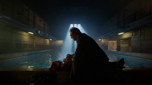 Gerald_Crane_holding_Scottie_Mullen_near_a_pool